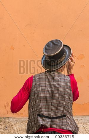 Illusionist With Magician's Hat During Street Performance