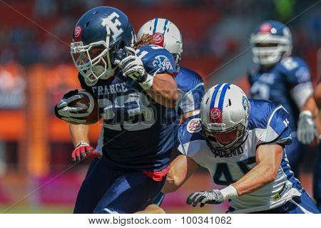 VIENNA, AUSTRIA - JUNE 7, 2014: RB Nguendjo Stephen Yepmo (#23 France) runs with the ball.