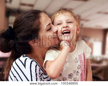 Beautiful Young Mother Hugging Her Joying Happy Daughter