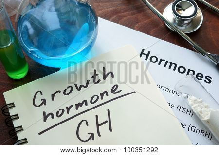 Hormone growth hormone written on notebook.