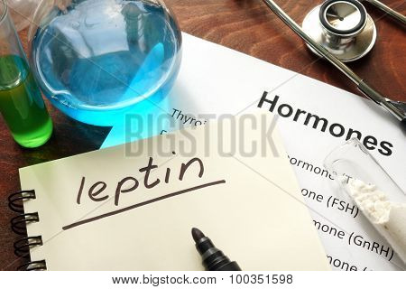 Hormone leptin written on notebook.