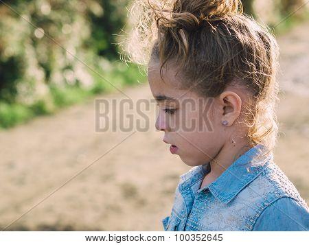 Little Girl Lookin Aside Outdoors