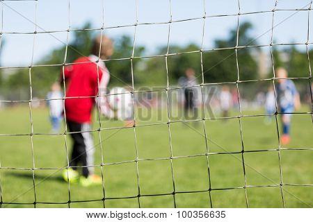 Goal Net And Blurred Goalie