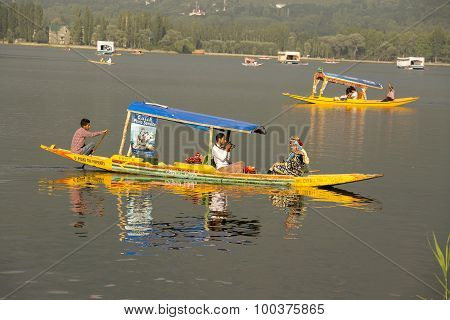 Boat And Indian People In Dal Lake. Srinagar, Jammu And Kashmir State, India