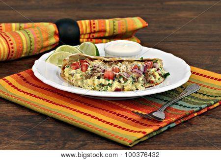 Breakfast Taco Of Eggs, Cheese, Onion And Churizo