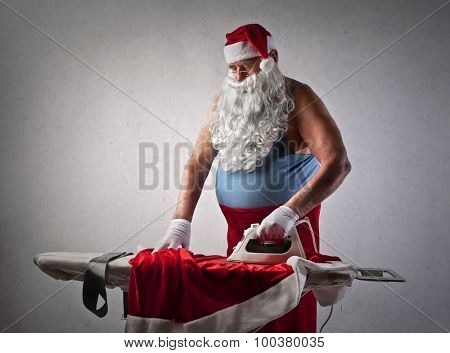 Santa Claus doing the ironing