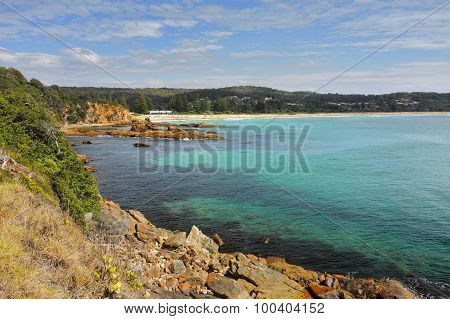Tathra is a seaside village on the far south coast called the Sapphire Coast in the Bega Valley shire. Views from the rocky headland looking back towards Tathra beach.on a beautiful sunny day poster