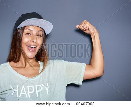 Playful Young Woman Pumping Her Muscles