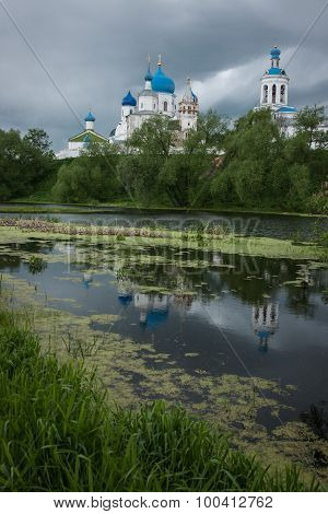 Image of white church with blue domes and scenic clouds Bogolubovo Russia poster