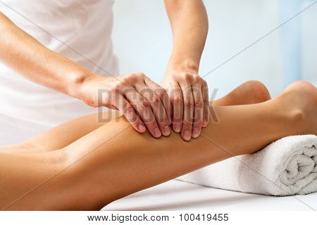 Detail Of Hands Massaging Human Calf Muscle.