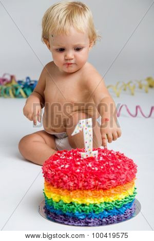 Baby Girl Celebrating Her First Bithday With Gourmet Cake.