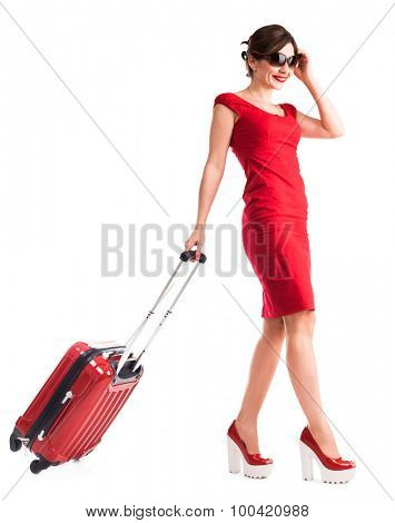gilr with suitcase going on vacation