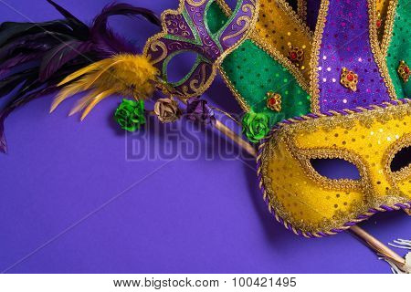 Mardi Gras or carnival mask on bright purple background poster