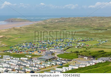 View from Rhossili Down to Burry Holms and Hillend The Gower peninsula Wales UK in summer with caravans and camping on the campsite poster