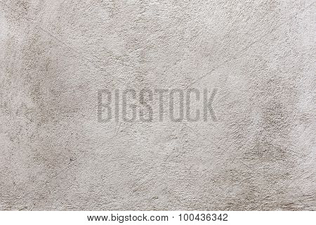 Old vintage plastered stucco wall brushed texture abstract background in neutral color