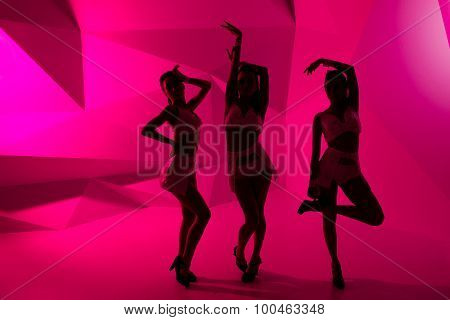 Silhouettes Of Dancing Girls