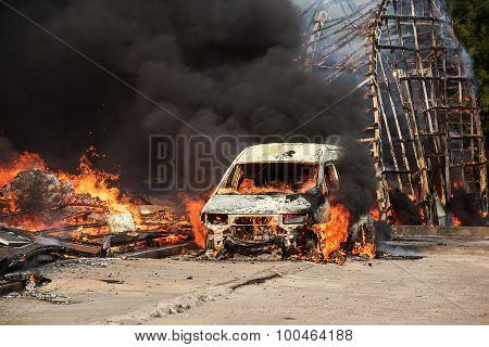 Huge fire of buildings and cars