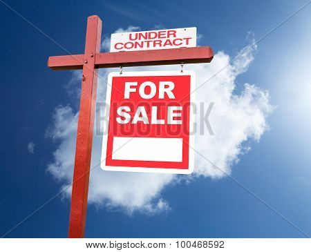 For Sale Sign For Home In Front Of Blue Sky