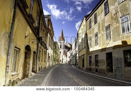Deserted street in an old and beautiful European town with cobblestone streets and rundown buildings