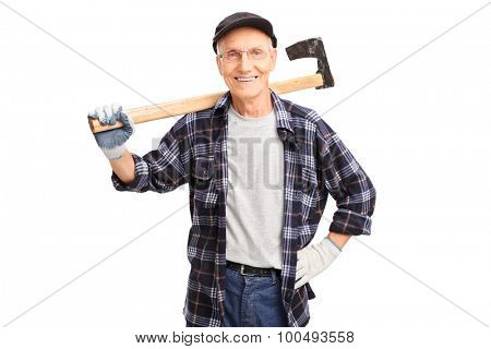 Studio shot of a cheerful senior logger holding an axe and looking at the camera isolated on white background