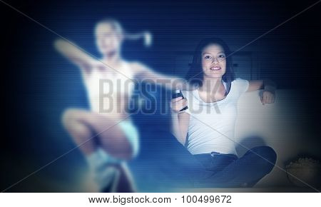Young girl with popcorn watching sport competition on telly