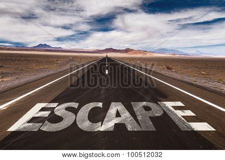 Escape written on desert road