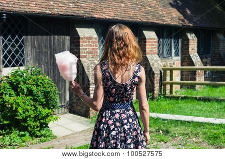 Young Woman With Candyfloss Outside