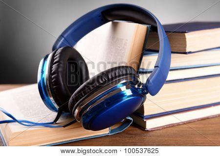 Books and headphones as audio books concept
