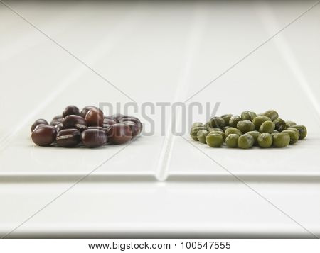 Pile of adzuki and mung beans isolated on white