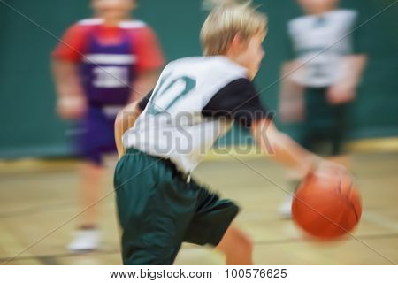 Youth basketball motion blurred image.