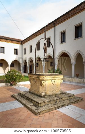 Old Well In The Center Of The Cloister