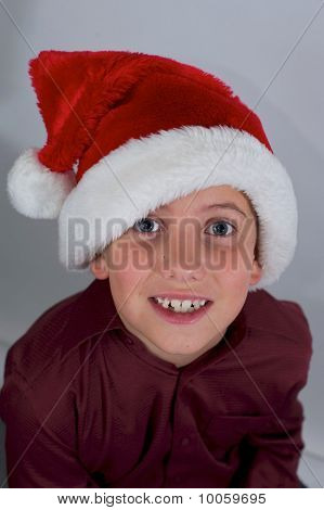 Close Up Of Boy With Santa Hat