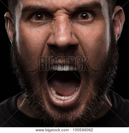 Close-up portrait of angry man