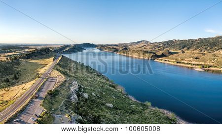 aerial panorama of southern part of the Horsetooth Reservoir near Fort Collins, Colorado, late summer scenery with a trailhead and parking