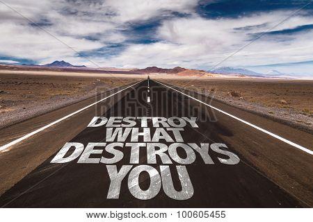Destroy What Destroys You written on desert road