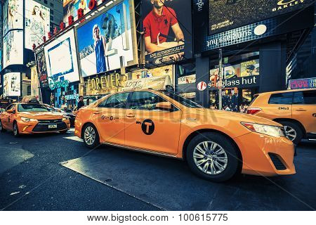 NEW YORK CITY - JULY 10: Taxi on Times Square an iconic street of New York City and America July 10 2015 in Manhattan New York City. Special photographic processing