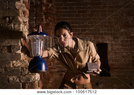 Brunette With A Lantern Search Treasure In The Ruins