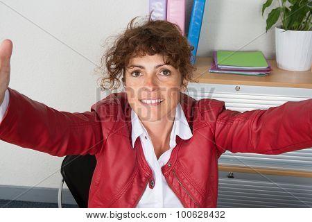 Woman At Work  Happy And Looking At The Camera