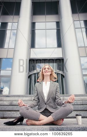 Beautiful young woman is relaxing after hard working day