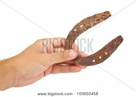 Horseshoe on a hand isolated white background. Good Luck concept.