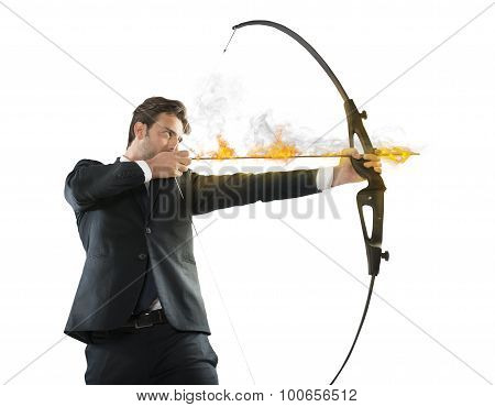 Determinated businessman with flaming arrow takes aim poster