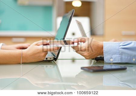 Man Is Giving Smart Mobile Phone To Woman Next To Laptops, Overuse  Of Internet And Social Media