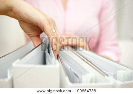 Businesswoman Is Inspecting Documentation