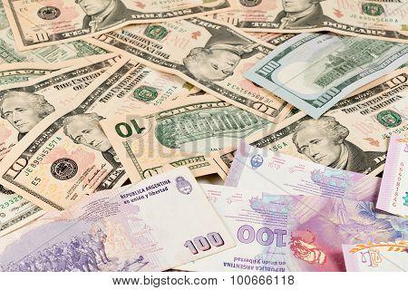 Us Dollar And Argentine Peso Bills