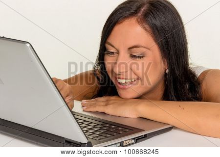 a young woman with a laptop computer. symbolic photo for communication and modern media.