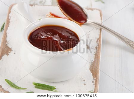 Sweet Bbq Sauce In  A White Bowl.