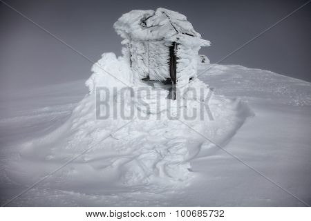 Frozen snow covering an old meteo station in Svalbard Norway
