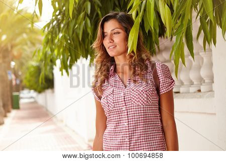 Cheerful Woman Looking Away Through Green Branches