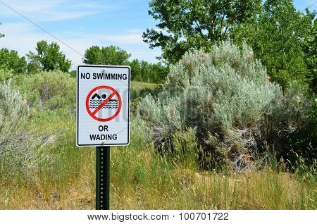 No Swimming or Wading sign