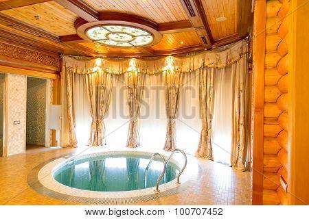 Novi Petrivtsi, Ukraine - May 27, 2015 Mezhigirya residence of ex-president of Ukraine Yanukovich. Luxurious room with indoor swimming pool